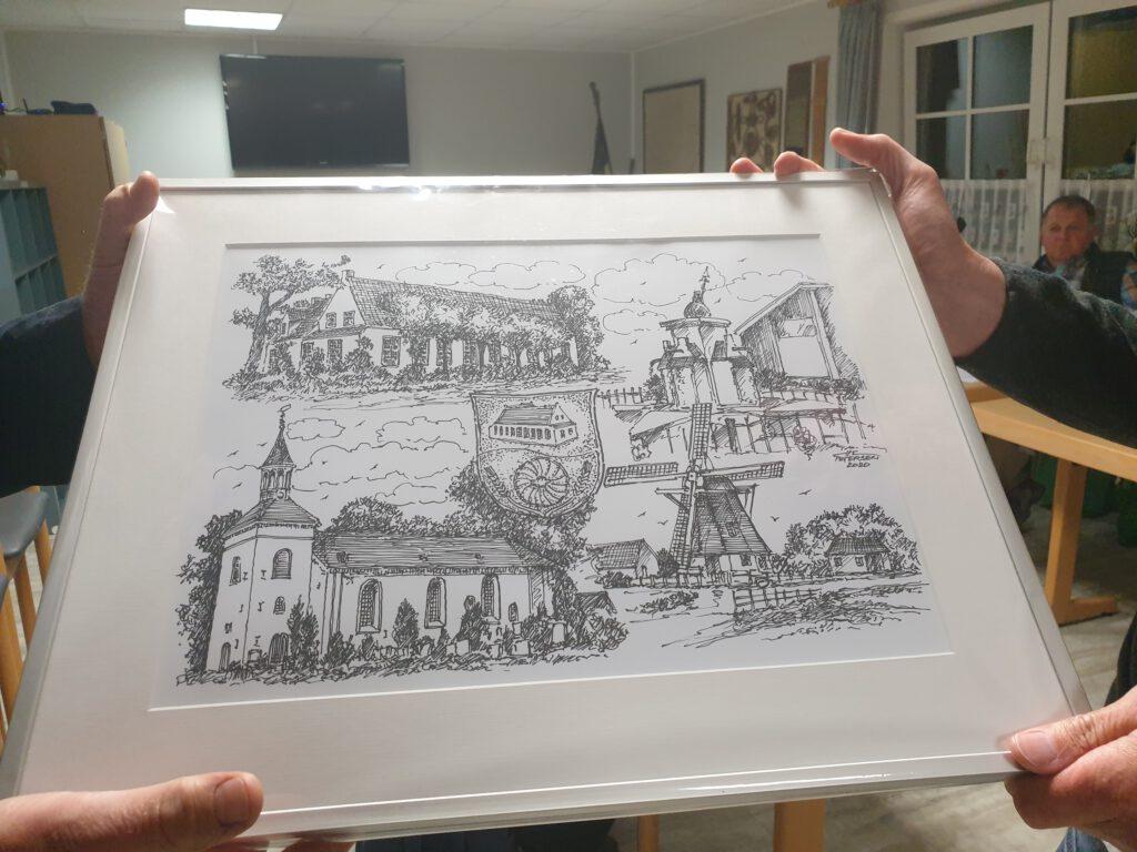 Zur Erinnerung überreichte er eine Collage, gefertigt von Hans-Christian Petersen